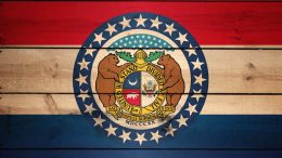 Missouri flag on wooden background