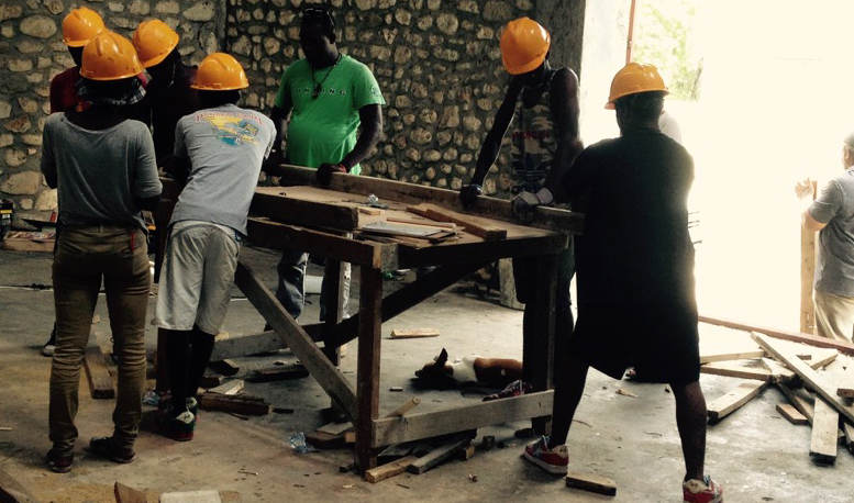 Workers assemble frame components for Port au Prince project.